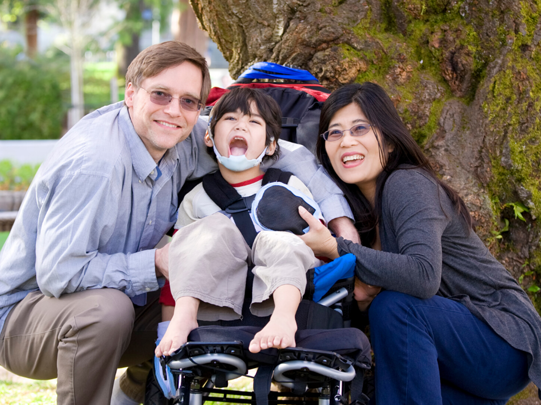 Family with child on a wheelchair